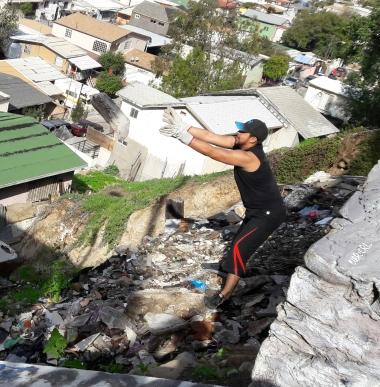 Nico showing us how it's done. Neighborhood beautification with Cleanerjuana. Del Rio, Tijuana