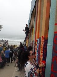 Gringo on a ladder. Border wall painting, Playas de Tijuana