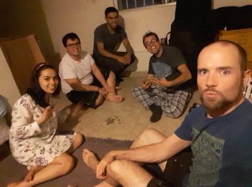 Playing a few late-night rounds of Pirinola (Toma Todo) with roommates. Bachelor pad, Zona Rio, Tijuana