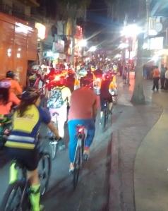 Biking through Calle Coahuila on a Friday night Paseo de Todos ride